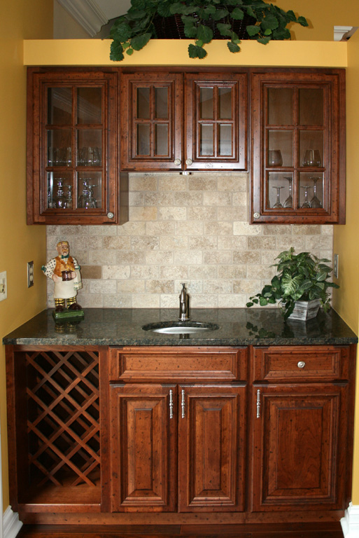 Cherry Wet Bar With Stone Backsplash
