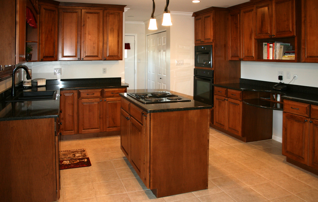 Explore st louis kitchen cabinets design remodeling for Dark wood kitchen units