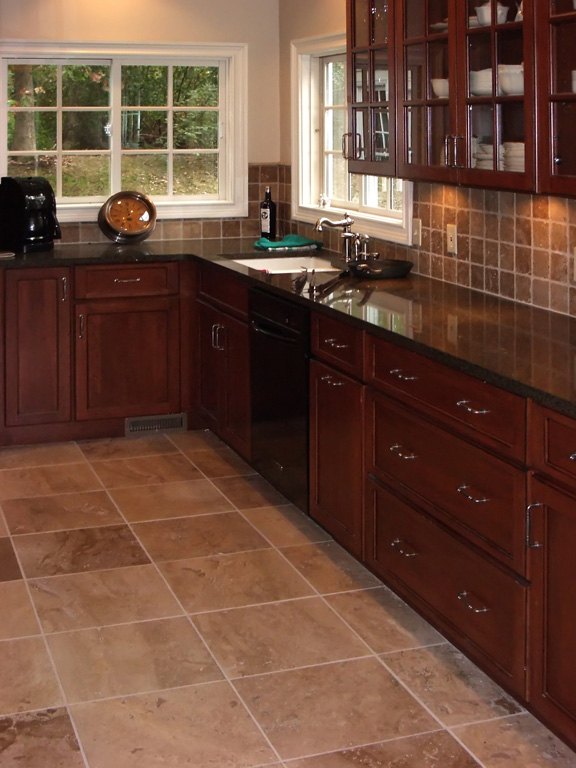 Matching Travertine Kitchen Floor and Backsplash and Cherry Kitchen Cabinets