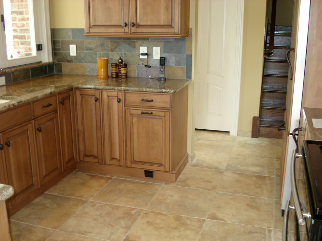 Glazed maple kitchen cabinets with tile floor and slate backsplash