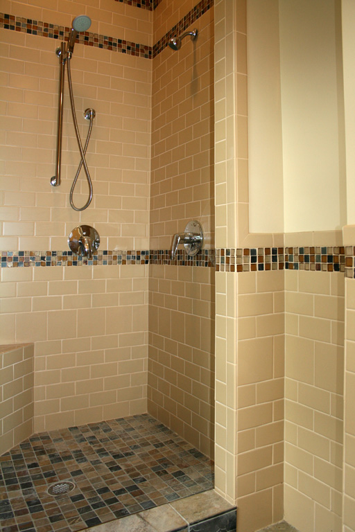 slate shower floor with subway tile walls