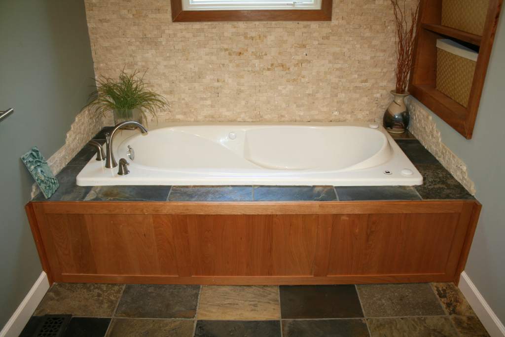 Travertine and slate tub surround with slate floor